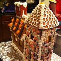 My First Gingerbread House  This was so much fun but alot of work as I designed the house myself and made drew each piece by free hand. If I had to do it over again I...