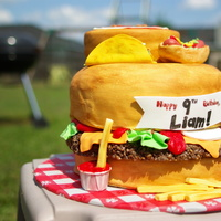 "Junk Food Cake Done For My Sons Ninth Birthday Everything Was Edible Except For The Paper Cup Holding The Ketchup The Hamburger Patty W Junk food cake done for my son's ninth birthday. Everything was edible except for the paper cup holding the ""ketchup"". The..."