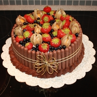 Birthday Cake For My Mom Chocolate cake with choc. buttercream filling. Fresh fruits and choc. fingers.