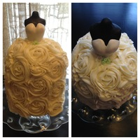 Bridal Shower Cake. The bust is the upper body of a doll with head and arms removed. Covered in black fondant, then layered in white fondant for the gown...
