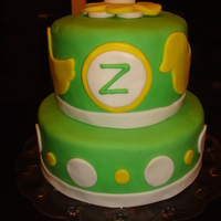 Rubber Ducky Cake This was made for a baby shower. The hostess requested the colors of spring green and yellow accents. The medallion in the center is the...