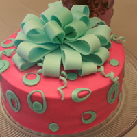 Bows & Loops   Red Velvet cake covered and filled with Cream Cheese frosting, Decorations were made of MMF.