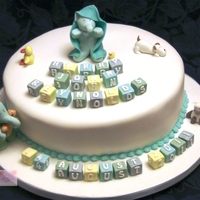 Baby Elephant Christening Cake Baby elephant in towel and nursery toys.