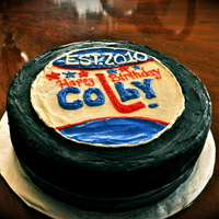 Hockey Puck Cake   12 inch round, all buttercream icing.
