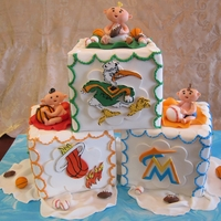 Sports Themed Baby Shower Blocks Babies made of gumpaste/modeling chocolate mix. TFL