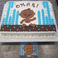 Happy Baby Coming   Buttercream with fondant decorations,buttercream borders. Design to match the partyware