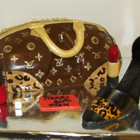 Louis Vuittion The shoe, lipstick, ring and nail polish are made from Gumpaste. The purse is a replica of the LV Leopard purse. All handpainted.