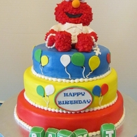 Elmo Baptism/1St Birthday This cake was done for a friend whos baby was celebrating his 1st birthday and baptism. All edible. Elmo made out of rice cereal then...