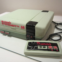 Nintendo Nes Inspired Birthday Cake  This was a special request by the birthday boy, my Hubby! It was by far one of the hardest cakes I've done, which is weird because it...