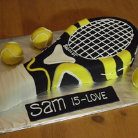 Racquet Cake 15Th Birthday This is the racquet that the birthday boy got from his parents. The tennis balls are rkt covered in fondant.Thanks for looking!