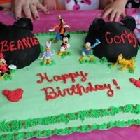 Mickey Mouse Cake This is a cake I made for my niece and nephews bday. The cake is french vanilla with strawberry filling and white chocolate frosting. The...