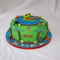 "Red-Eyed Tree Frog Cake 10"" chocolate cake with chocolate cream cheese filling. Buttercream iced. All frogs are plastic. Thanks!"