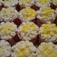 Popcorn Cupcakes Circus themed cupcakes topped with marshmallows made to look like popcorn