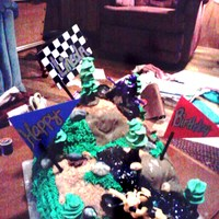 Dirt Bike Birthday Cake Two dirt bikes racing up hill