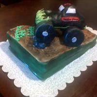 Grave Digger 2 9x12 all buttercream airbrused and truck is rice treats.