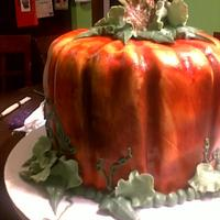 Pumpkin Cake THIS WAS A FUN CAKE, 3 8in ROUND COVERED IN MARSHMELLOW FONDAT, AND I AIRBRUSHED THE COLOR WITH GUMPASTE LEAVES AND BUTTERCREAM LEAVES AND...