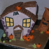 Spooky Halloween House Halloween house made of cake, krispies, marzipan. Zombie and tombstone were a five minute rush job at the end.
