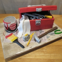 Handyman Birthday Toolbox is chocolate chip cake with chocolate fudge and peanut butter cup filling. Lid and paint can are RKT. Tools are gumpaste and/or...