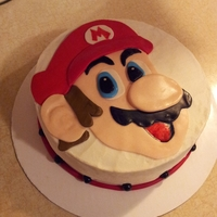 Mario Cake   This cake for a little girl that absolutely loves Mario. The cake is marble with chocolate bc filling.