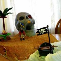 Pirate Skull Island Cake Skull Made Using Wilton 3D Skull Pan Cutting Teeth To Make Open Mouth Island Was Also Cake Covered In Frosting Pirate skull island cake. Skull made using Wilton 3D skull pan, cutting teeth to make open mouth. Island was also cake covered in frosting...