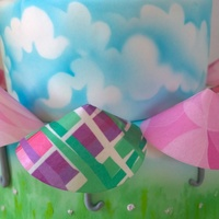 Spring Umbrella The top tier is almond cake that I airbrushed. The bottom tier is fondant covered like the top. I airbrushed the sky and grass on the...