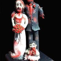 "Zombie Cake Topper This topper is made of Sculpy III with a painted wood base. It is approximately 6"" high. Unfortunately this photo doesn't show..."