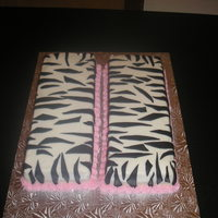 Zebra 11Th Birthday 9x13 sheet cake made into an 11. Zebra black fondant iced in buttercream