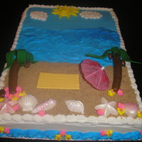 Beach Birthday Beach Birthday with fondant towel, Tootsie Roll and fondant palm trees