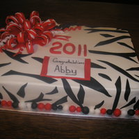 Grad Cake   2 layer 12x18 sheet cake. Fondant zebra stripes and my 1st fondant bow!