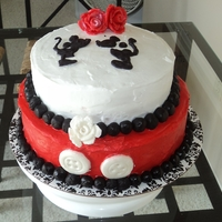 Mickey Themed Bridal Shower Cake This cake was covered in buttercream icing. Roses and black pearls were made from marshmallow fondant. Mickey and Minnie were made from...