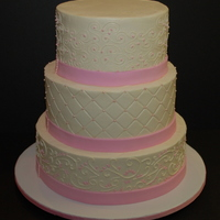 "Pink & White Wedding Cake Three tier wedding cake in pink and white.It's an 8""/10""/12"" cake frosted in buttercream with fondant ribbon. Top and..."
