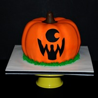 Halloween Jack-O-Lantern Cyclops Pumpkin Cake Halloween Pumpkin Jack-o-Lantern style Cyclops Cake. Made from 2 bundt cakes and slightly carved to look more like a pumpkin. Frosted in...