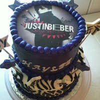 Justin Bieber Cake is all buttercream even zebra print. name is rolled buttercream. Stars are gumpaste.