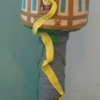Rapunzel Tower A Tangled themed Rapunzel's tower cake made for our daughter's 5th birthday. Chocolate and Vanilla with hazelnut buttercream. She...