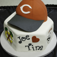 Cincinnati Reds/sports Lover Groom's Cake Chocolate cake with oreo filling. Entire cake covered with MMF. Hand drawn plaques on gumpaste for all sports logos.