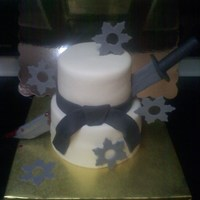 Ninja Ninja birthday cake, gumpaste sword and stars