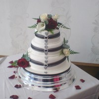 "Winter Wedding Cake   This is a three tier carrot cake 12"",10"" and 8""."