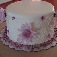 "Top Cake Red velvet 8"" round, filled and frosted with butter cream. Decorated with fondant, royal icing and fresh flowers. to go on top of a..."