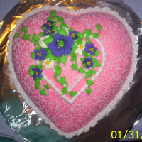 Pink Heart   Puffed heart pan, flowers made of Royal icing. Yellow cake with BC icing.