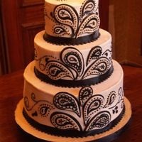 Ivory & Black Paisley Wedding Cake Accidentally deleted this. Sorry... Anyway, buttercream with fondant accents. This was my first stacked buttercream cake. Kind of sloppy...