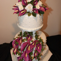 Wedding Cake With Roses And Lillies