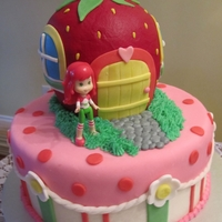Strawberry Shortcake all cake except figurine. strawberry is smoothed with buttercream.