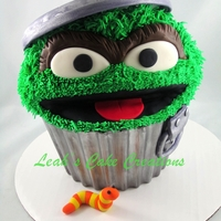 Oscar The Grouch Giant Cupcake giant cupcake made to look like oscars garbage can. gumpaste garbage lid, chocolate shell dusted with silver luster dust.
