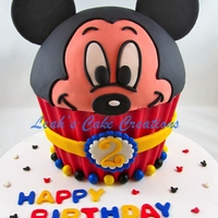 Mickey Mouse In A Giant Cupcake