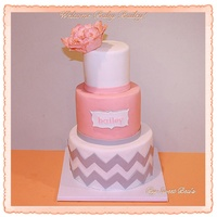 Coral And Gray Chevron Baby Shower Cake With A Gumpaste Molded Peony Coral and gray chevron baby shower cake with a gumpaste molded peony.