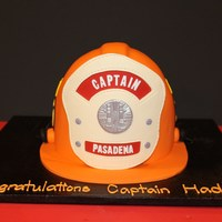 Fire Captain Cake Promotion Cake I recently created for a fireman's promotion to captain. Helmet is an exact replica of his own fire helmet.
