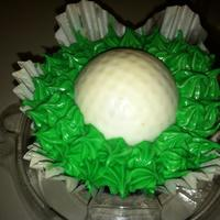 Golf Cupcake Chocolate Cupcake topped with a white chocolate golf ball