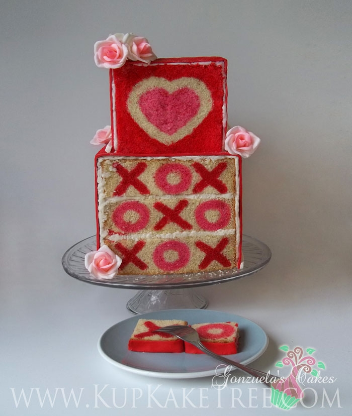 """inside-Surprise"" Valentine's Day Cake ...cutting into the cake exposes the heart and X's & O's :-)"