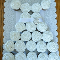 Cupcake Wedding Dress   Cupcakes frosted then sprinkled with luster dust. Non edible ribbon and pin.