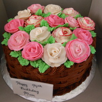 Rose Basket   Yellow cake and chocolate buttercream filling and frosting. All buttercream roses